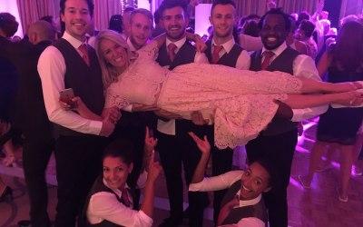 Dancing waiters at a wedding