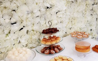 Our flower wall set up with our dessert display.