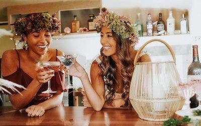 Bride and Bridesmaid enjoying the bar