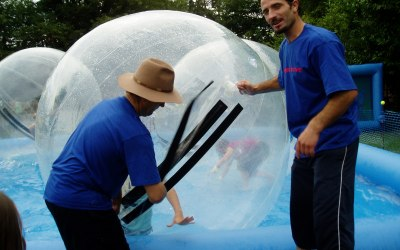 Exiting a waterzorb. Our staff wear logged shirts for ease of identification.