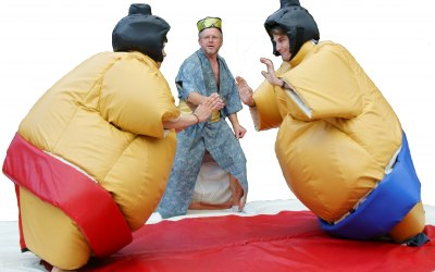 Your Gyoji refereeing a fight with Sumo Experience Adult suits