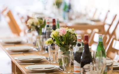 Oak Trestle tables and wooden chairs