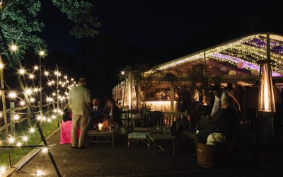 A clearspan marquee lit with fairy lights
