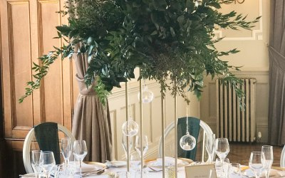 Gold Planters with Foliage Spray & Hanging Baubles at Matfen Hall
