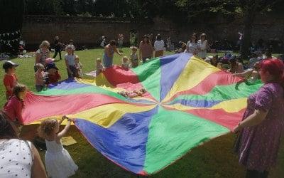 Parachute games at a public picnic event