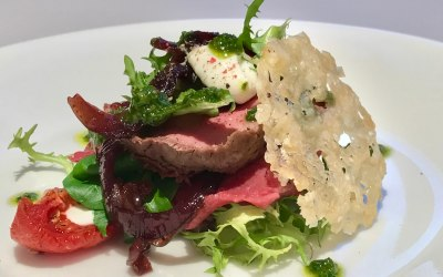 A light salad of fillet beef with horseradish cream and a parmesan crisp