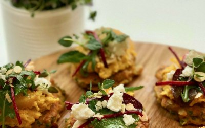 Carrot fritters with humus, beetroot salad and feta for a buffet