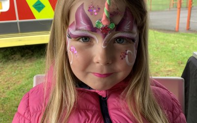 Over the rainbow face painting and glitter  6