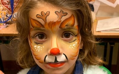 Over the rainbow face painting and glitter  5