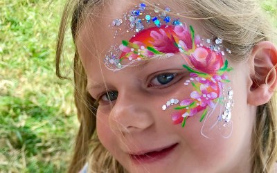 Over the rainbow face painting and glitter  7