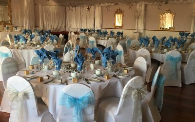Chair covers and sashes for wedding reception
