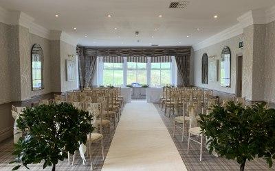 Wedding ceremony, aisle carpet and bay trees