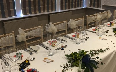 Top table with double bows tied to side