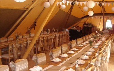 Venue styling - hessian runners, tipi