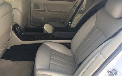 Inside white Bentley