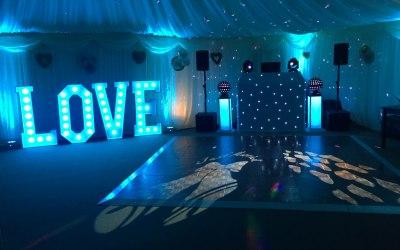 Ice blue wedding DJ & love letter setup