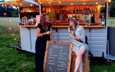 The bride & bridesmaid deep in conversation at the hen party..