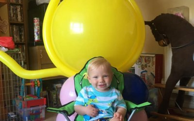 Happy little birthday boy with his giant balloon lion!