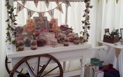 We provide the Candy Cart, Jars, and Scoops - you fill the jars with the sweets of your choice!