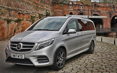 Luxury Mercedes 8 seater mini bus which holds up to 8 large suit cases