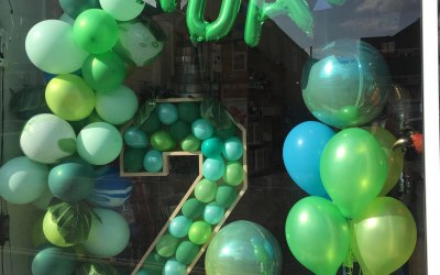 4ft Numbers Filled With Balloons along with a Balloon Garland and an Orbz Display.