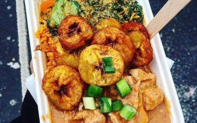 Jollof rice, fried plantains, spinach and agushi and peanut sauce