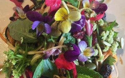 Papaya salad with edible flowers
