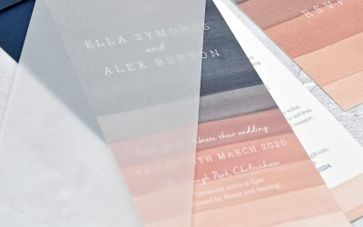 Watercolour striped invitations with vellum cover and brass fastener