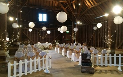 Lace chair covers, lanterns and fairy-lit heart