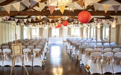 White chair covers & Hessian Sashes and Bunting.