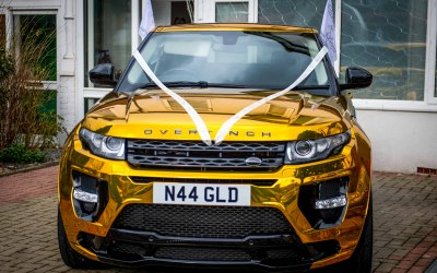 Gold Range Rover Front with Ribbon