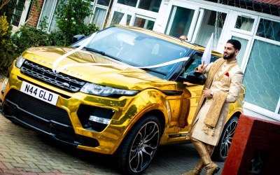 Groom with Gold Range Rover