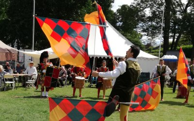 Flag jugglers at the Medieval Festival in Colchester