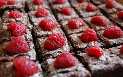 Brownies topped with fresh raspberries