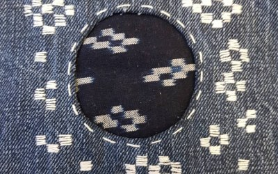Hitomezashi Sashiko mend using vintage Kasuri fabric on jeans