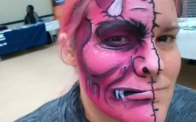 Pink monster face paint