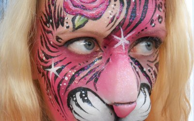 Pink tiger face paint with prosthetics