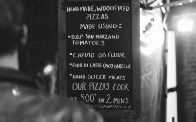 The wood fired pizza company menu board