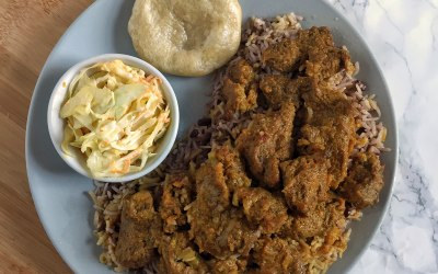 Not Curry goat with rice & peas, coleslaw, boiled cornmeal dumpling
