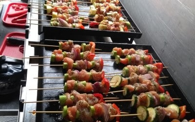 Delicious pork kebabs with peppers and tomatoes.