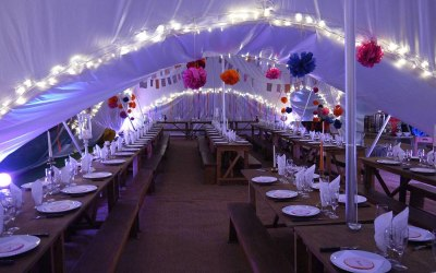 Capri marquee interior with uplighters and fairy lights