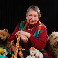 Tintagel Storyteller with StoryBasket and Cairn Terriers