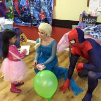 Elsa and Spider Man greeting the birthday girl