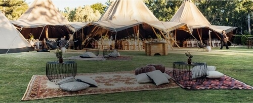 Add to Event hero image showing an event with several tipi marquees