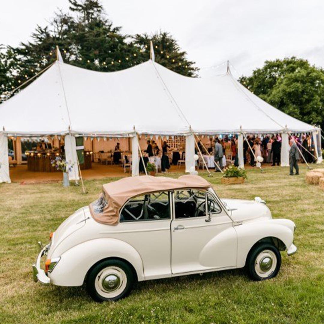 Classic car outside a marquee at a summer event