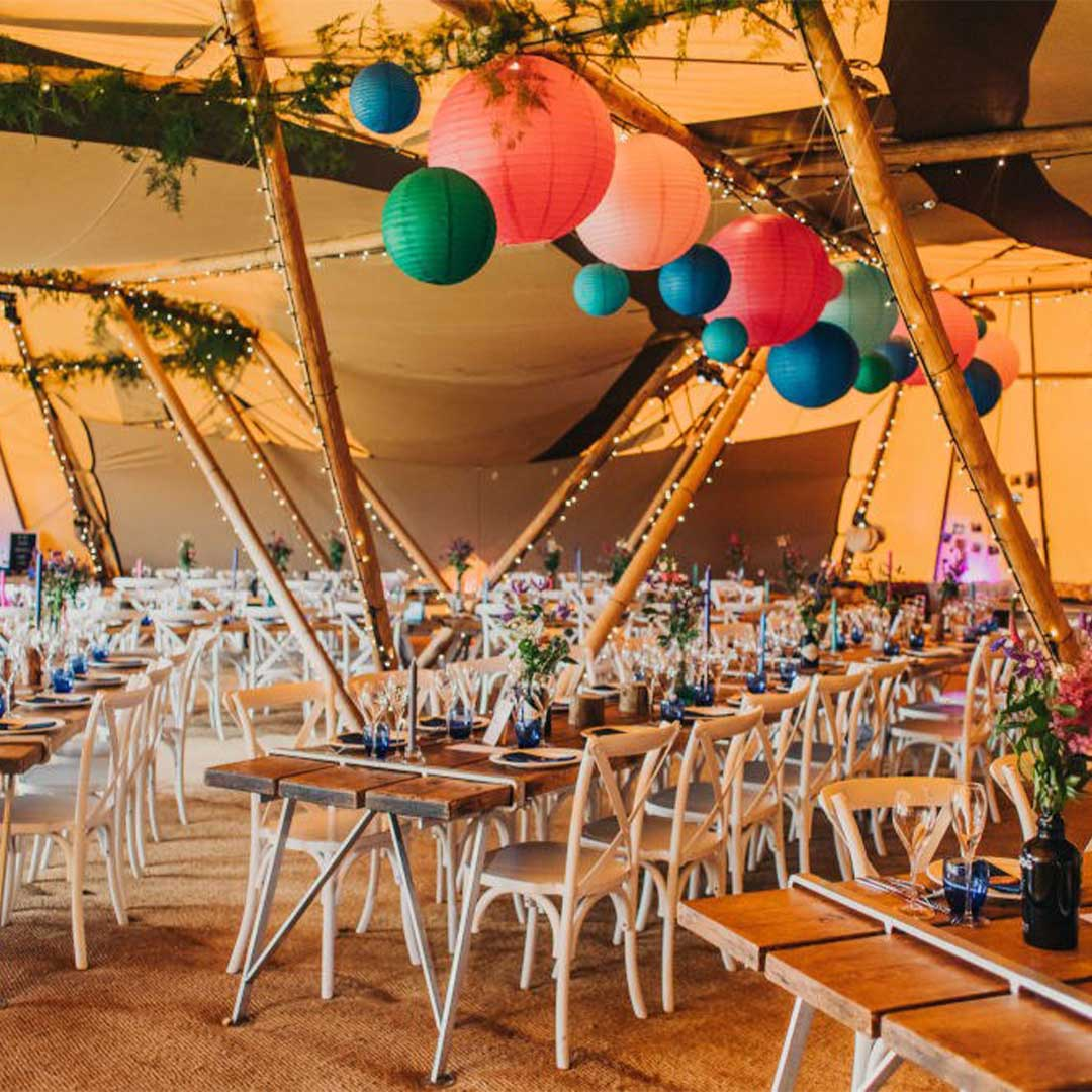 Internal table decorations for an event inside a large tipi