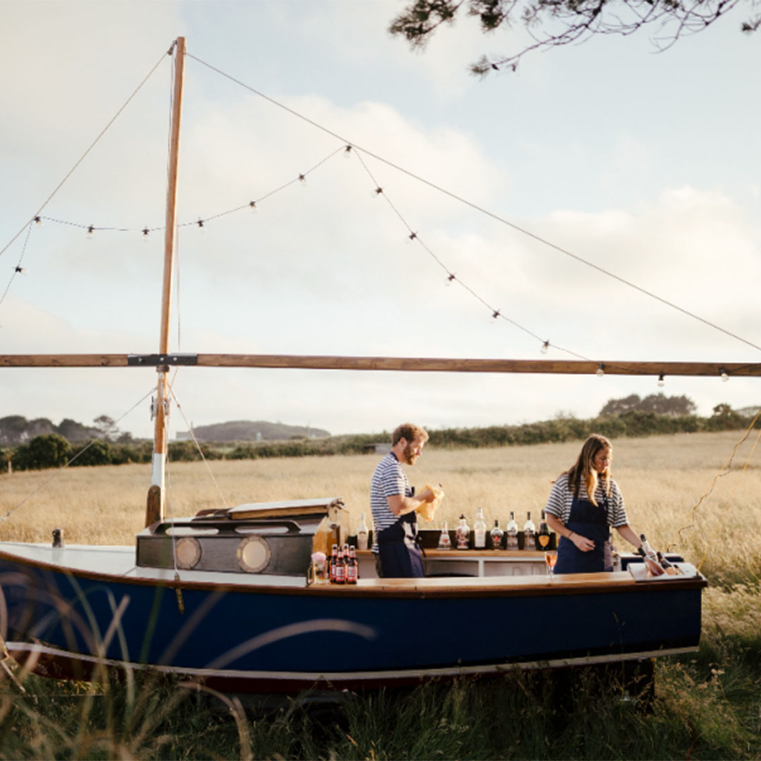 A boat that has been converted into a mobile bar